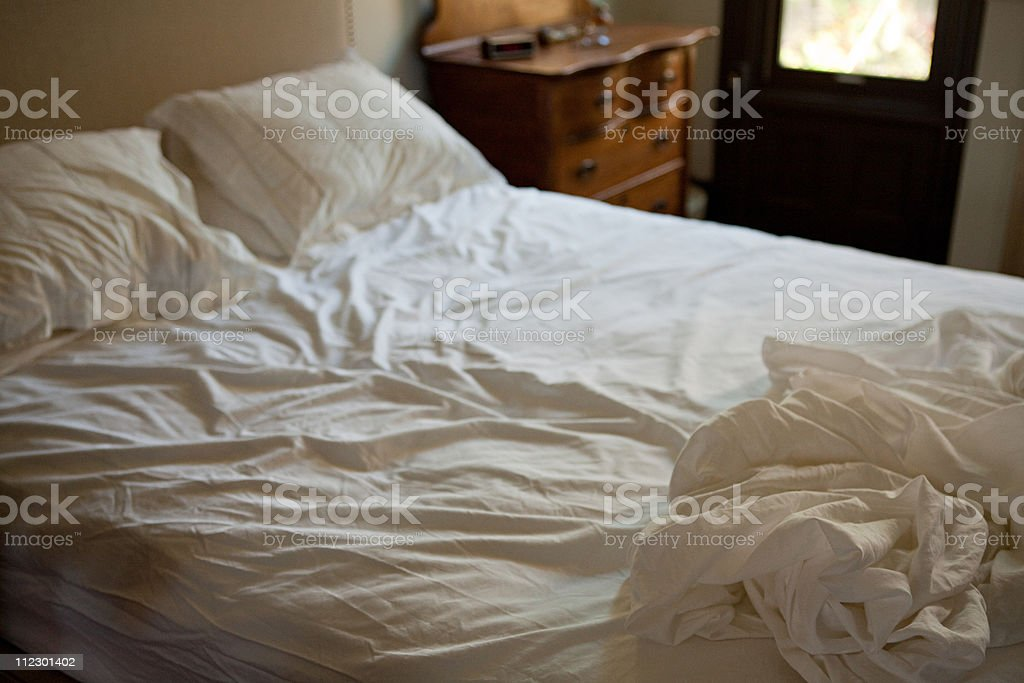 Crumpled bed sheets stock photo