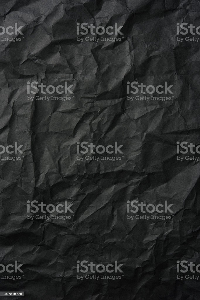 Crumpled black rice paper background stock photo