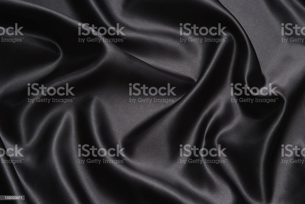 Crumpled black satin texture background royalty-free stock photo