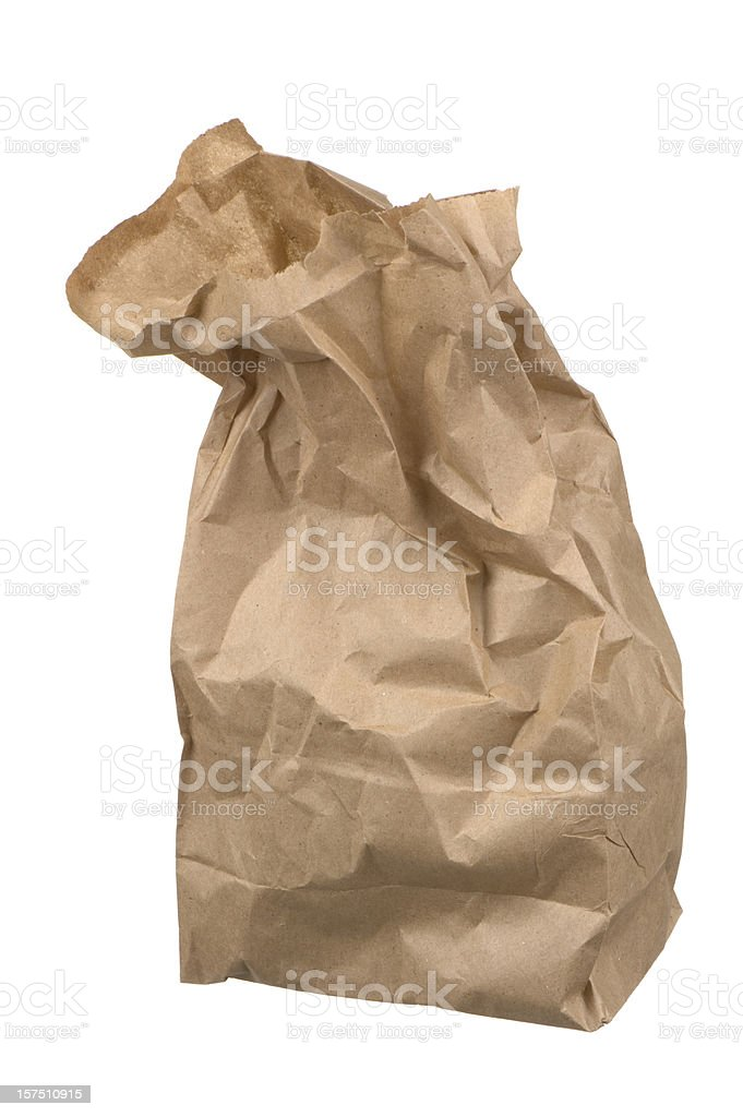 Crumpled brown paper lunch bag on white background royalty-free stock photo