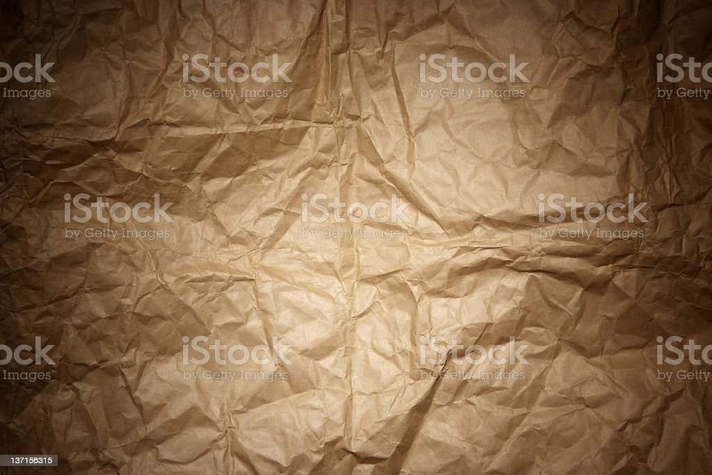 Crumpled brown paper texture background with spotlight royalty-free stock photo