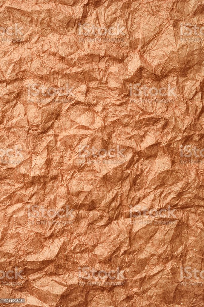 Crumpled brown rice paper background stock photo