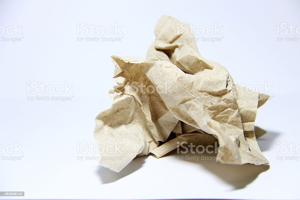 Crumpled brown tissue paper on white background stock photo