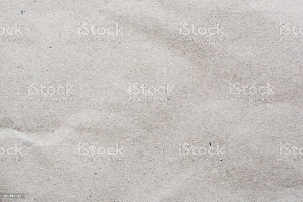 crumpled cream color tone paper pattern texture background stock photo