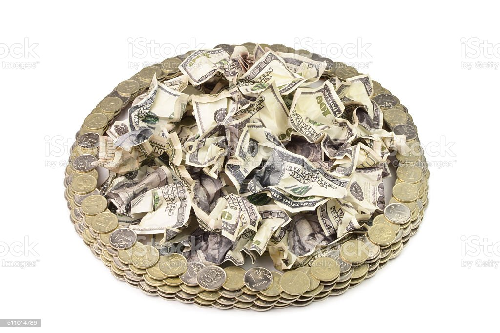 crumpled dollar and Russian coins stock photo