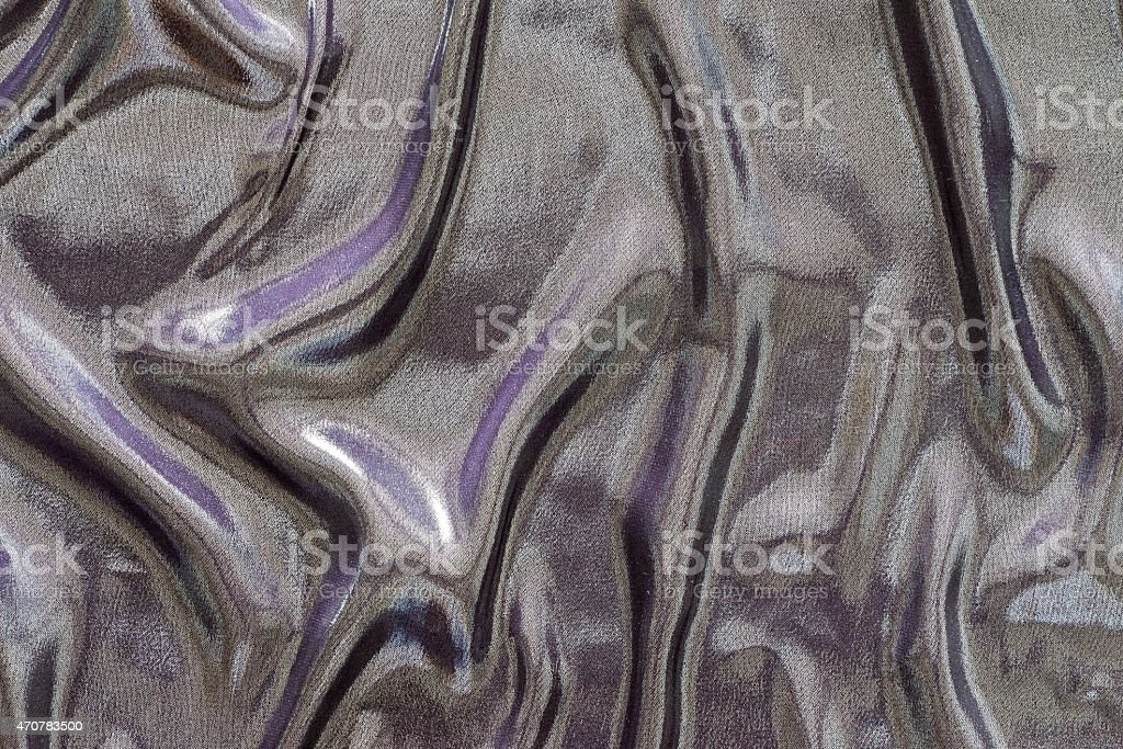 crumpled fabric of motley iridescent colors stock photo
