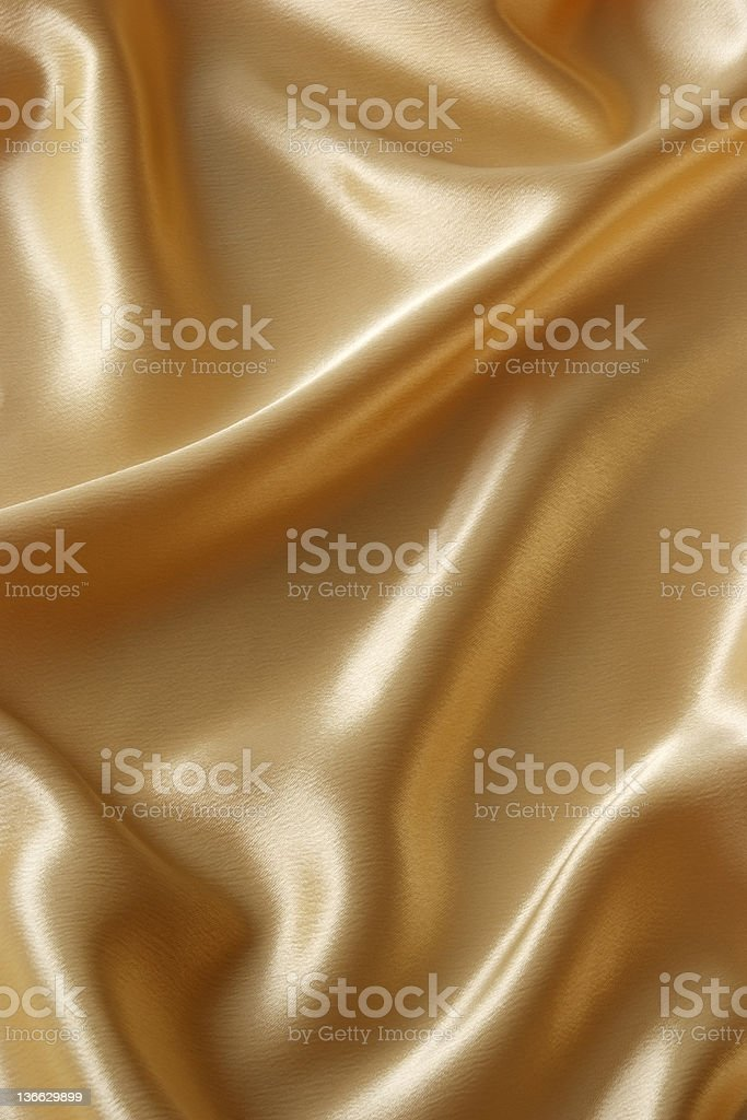 Crumpled gold satin texture background royalty-free stock photo
