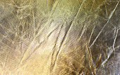 Crumpled golden Aluminum Foil Background Texture