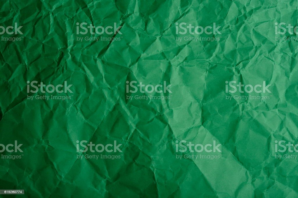 Crumpled green paper stock photo