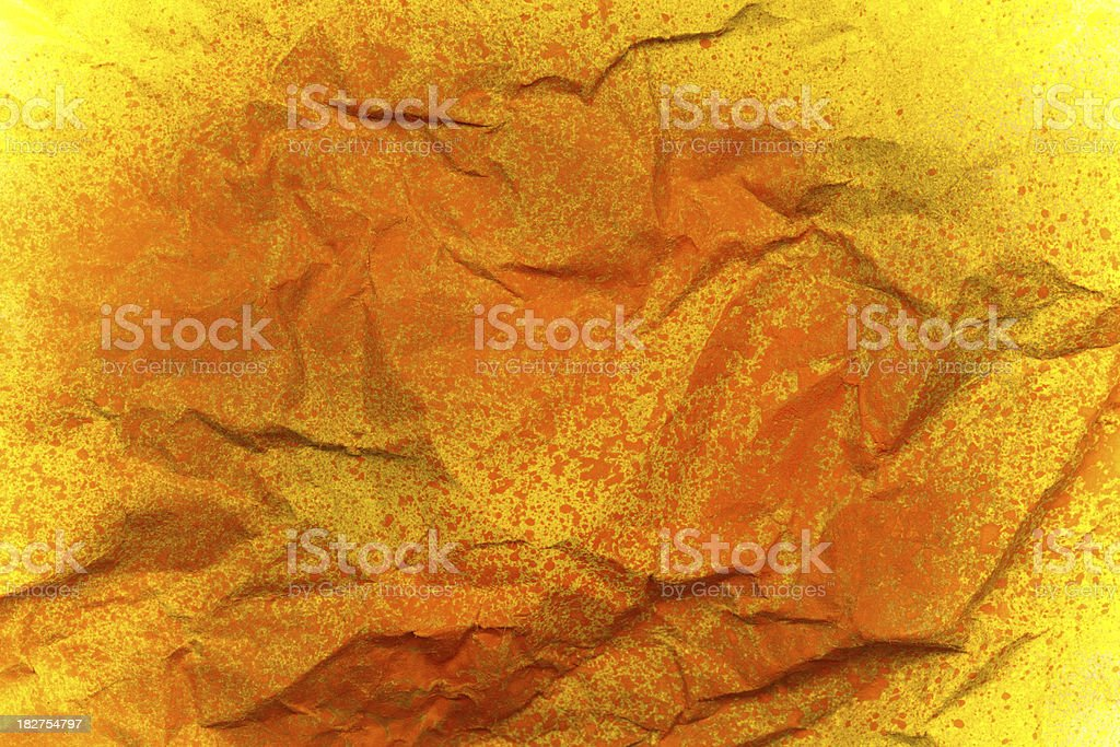 Crumpled kraft paper with spray paint background royalty-free stock photo