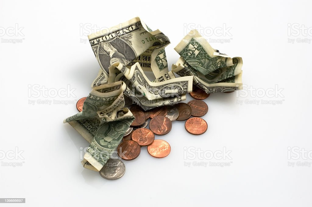 Crumpled one dollar bills and some coins on white background royalty-free stock photo