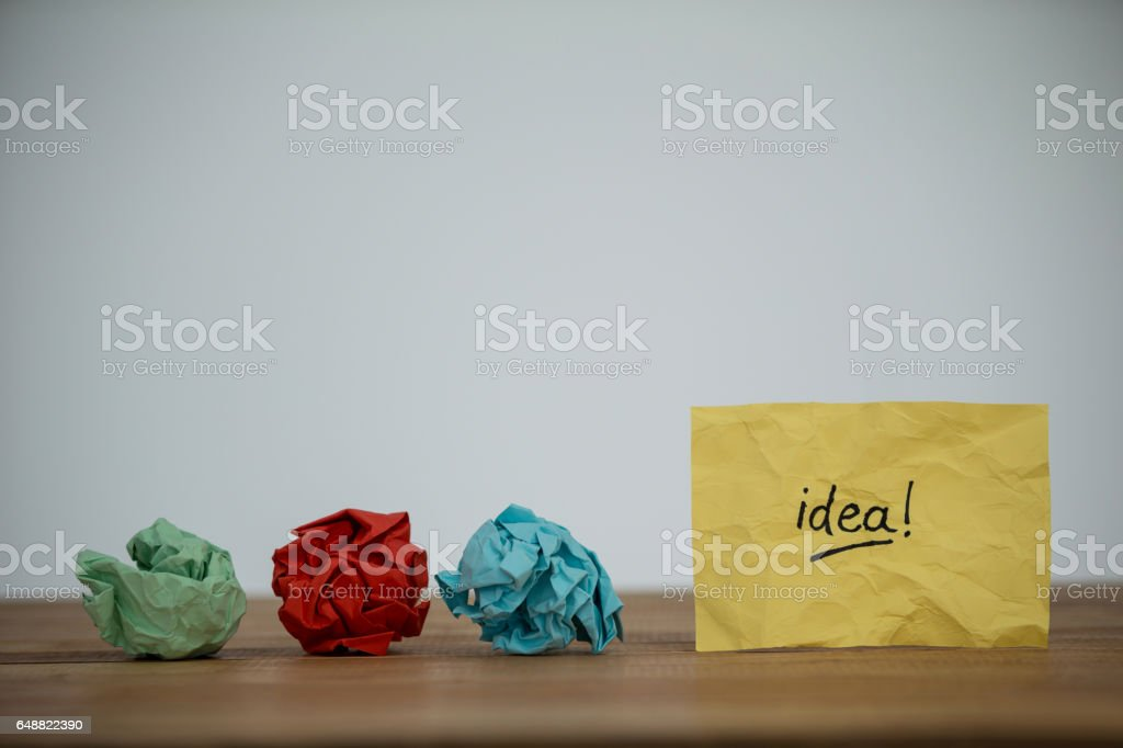 Crumpled paper and idea written on paper stock photo