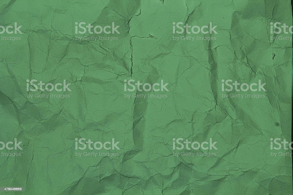 Crumpled  paper background texture green color. royalty-free stock photo