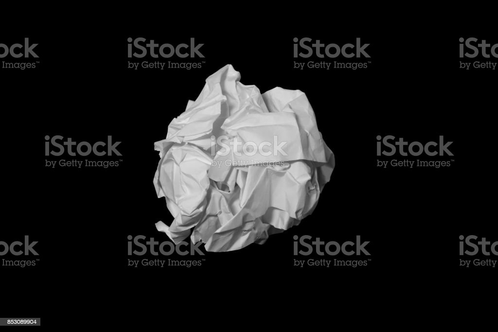 Crumpled paper ball isolated on black with clipping path stock photo