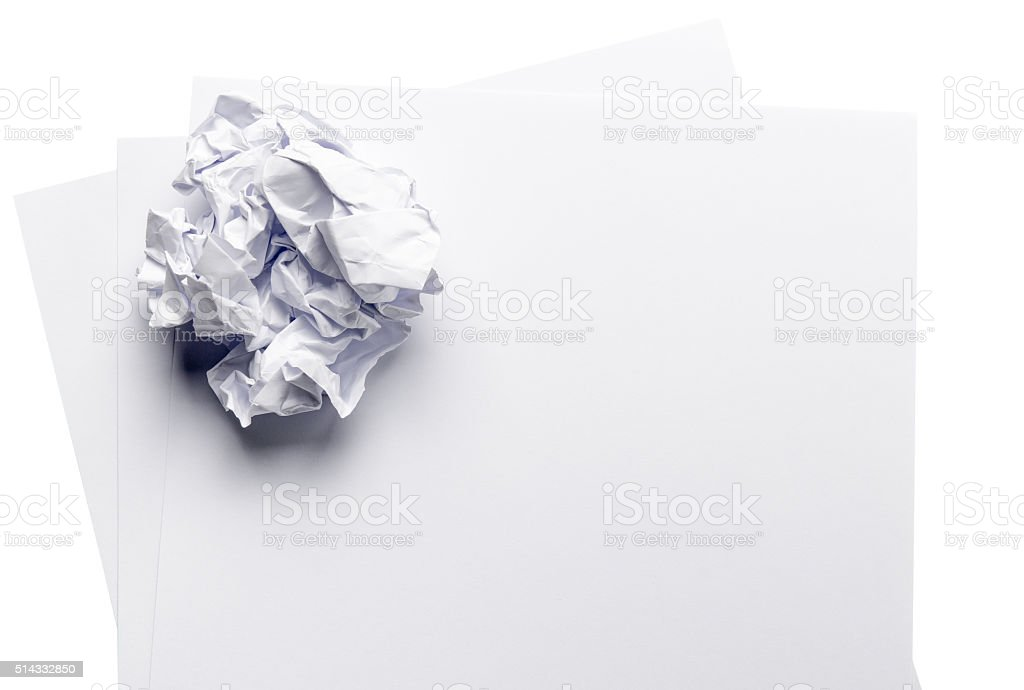 crumpled paper ball on white paper stock photo