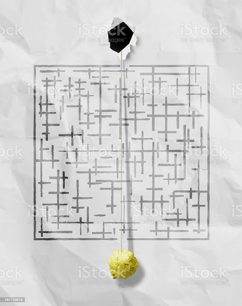 crumpled paper ball through sketch maze on wrinkled background royalty-free stock photo