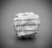 Crumpled paper ball with words Depression on gray background