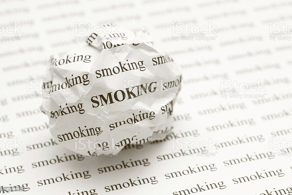 Crumpled paper ball with words smoking royalty-free stock photo