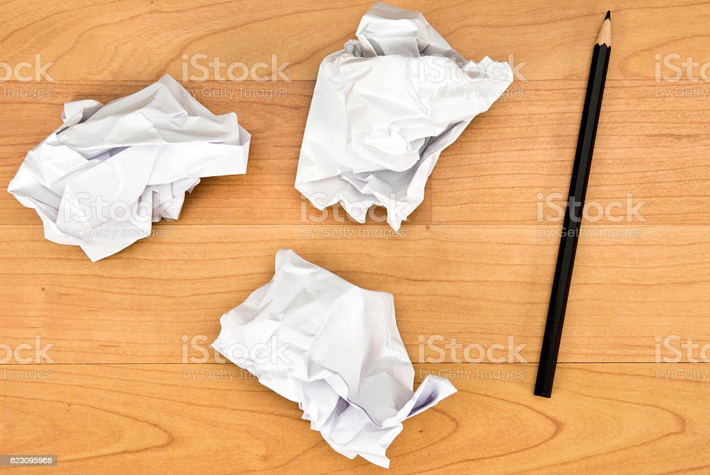 Crumpled paper balls on the desk stock photo