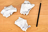 Crumpled paper balls on the desk
