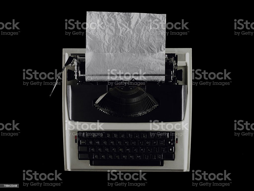 Crumpled paper in a typewriter stock photo