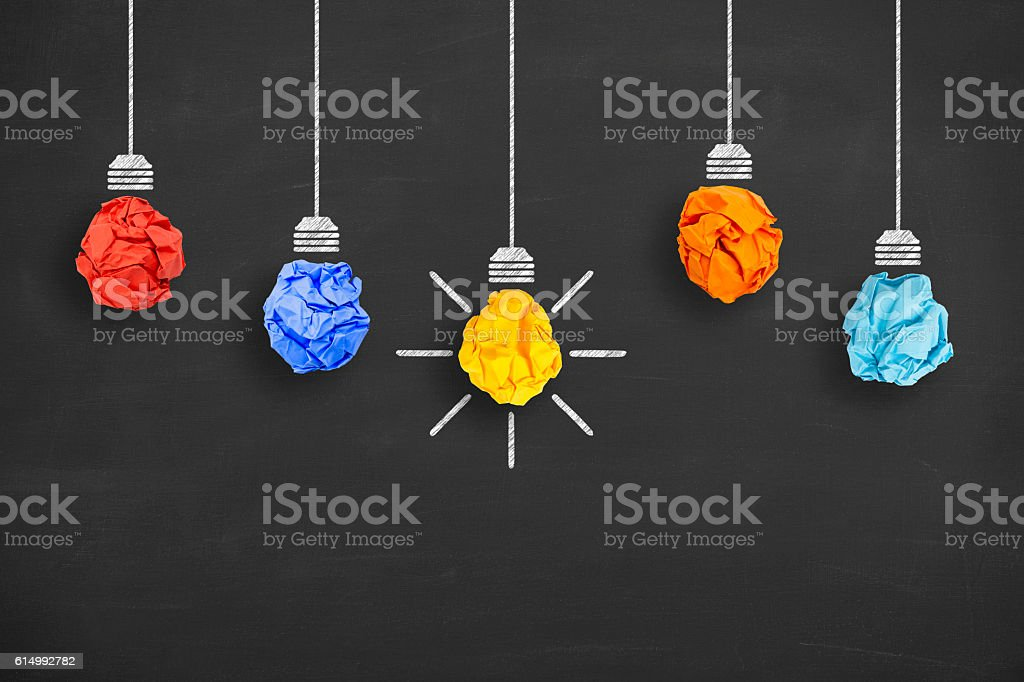 Crumpled Paper Light Bulb Idea Concept on Blackboard stock photo