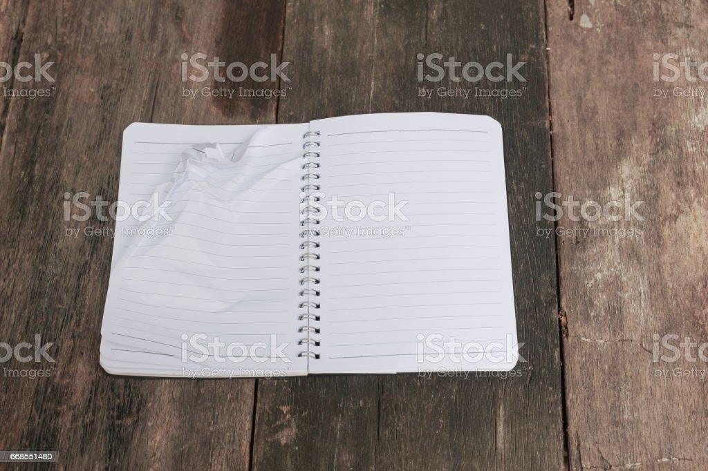 Crumpled paper lump and texture on blue table background stock photo