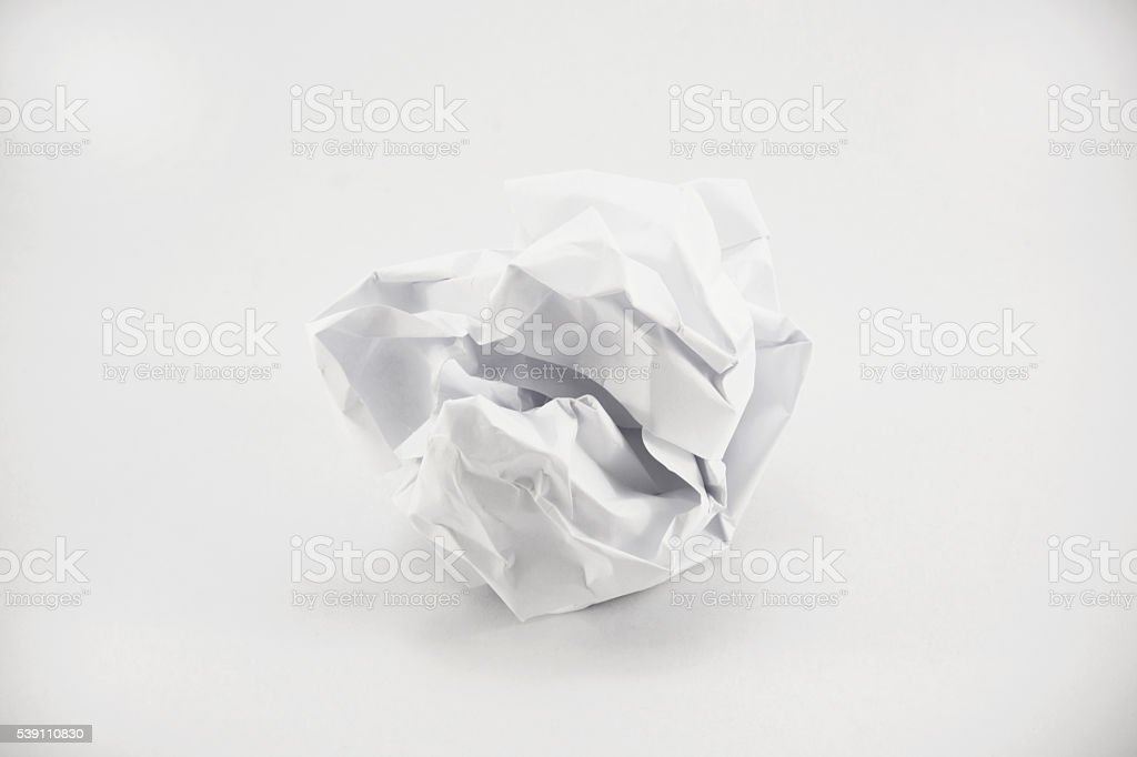 Crumpled paper on white background stock photo