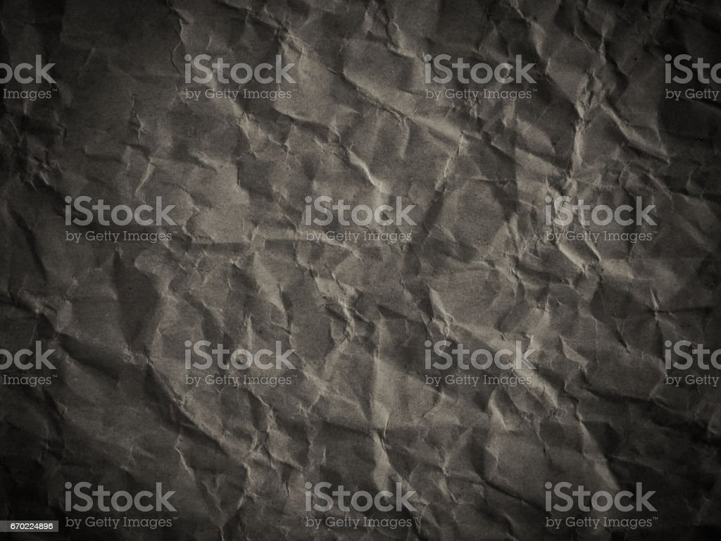 crumpled paper texture background with black and white effect stock photo