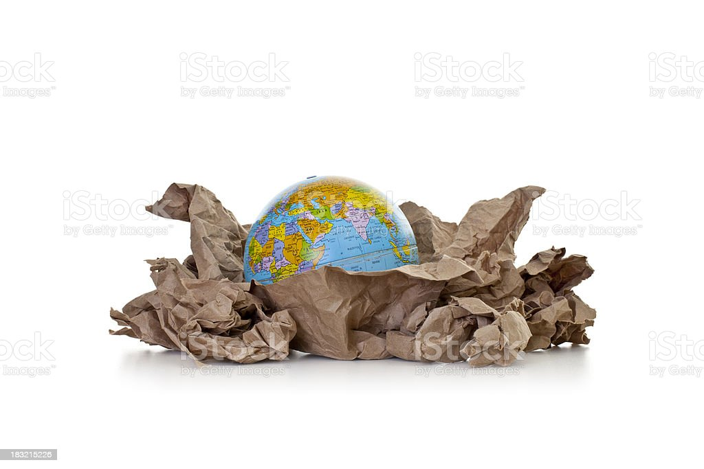 Crumpled paper with globe royalty-free stock photo