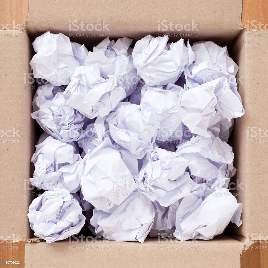 Crumpled papers in cardboard box royalty-free stock photo