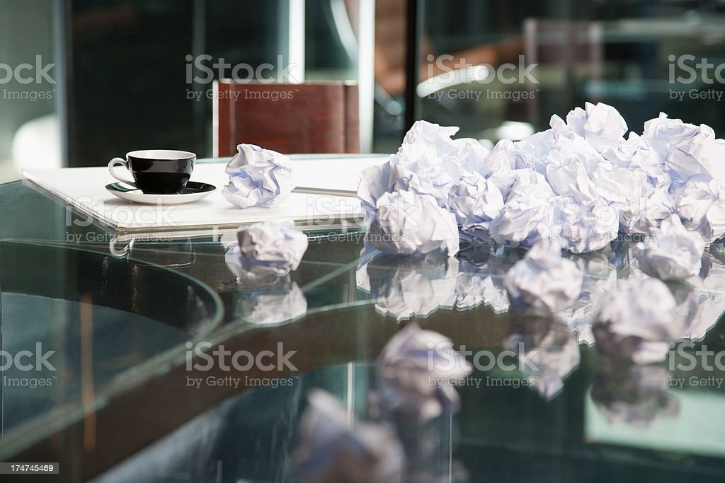 Crumpled papers on a table stock photo