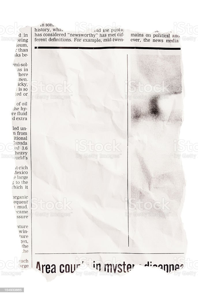 Crumpled torn out newspaper clipping with blank space stock photo