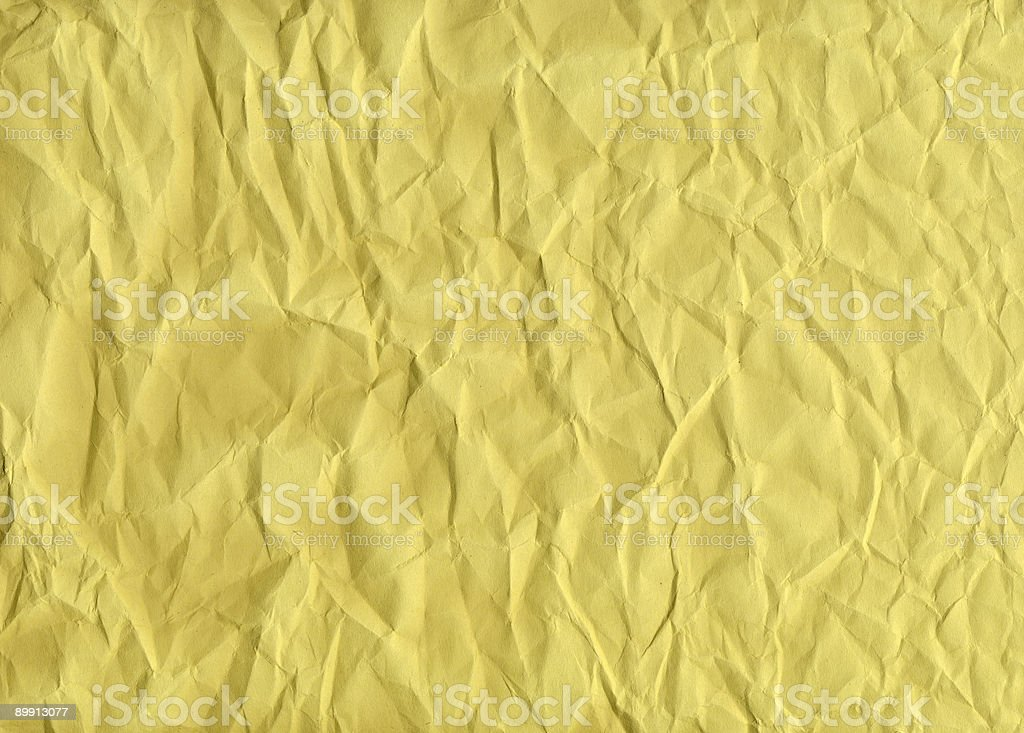 Crumpled Yellow Construction Paper Background stock photo