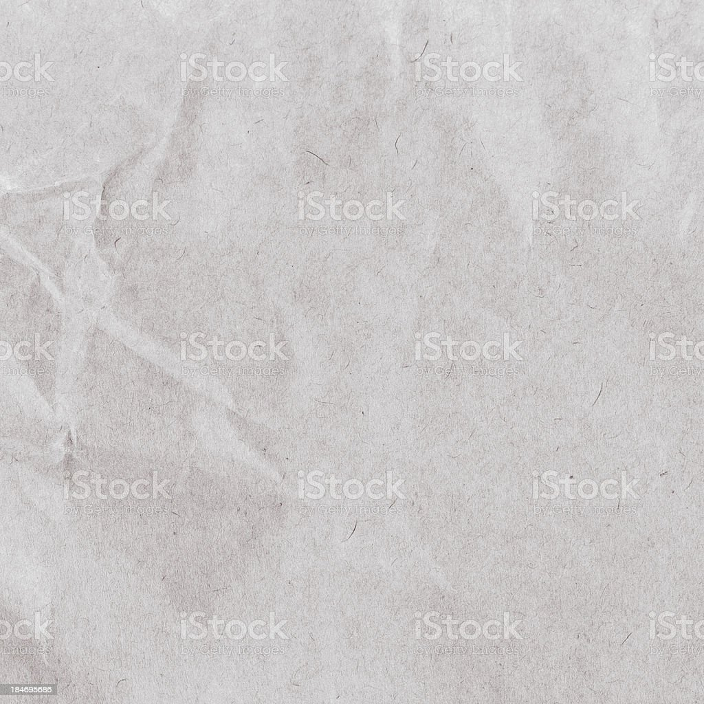 Crumpled yellow  recycled paper  texture or background. Vintage royalty-free stock photo