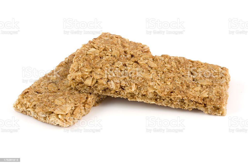 Crunchy oat granola bars isolated on a white background royalty-free stock photo