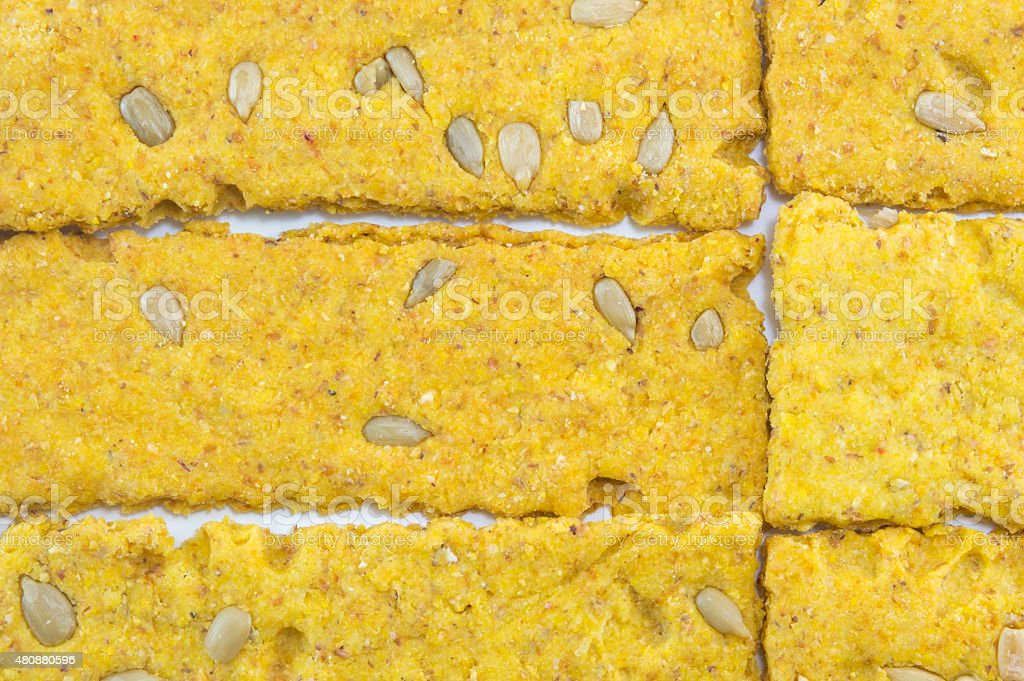 Crunchy oat thins with sunflower  forming pattern on white stock photo
