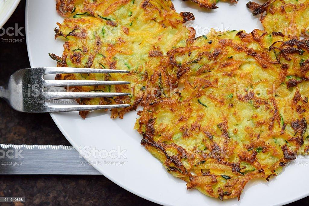 Crunchy potato and zucchini pancakes stock photo