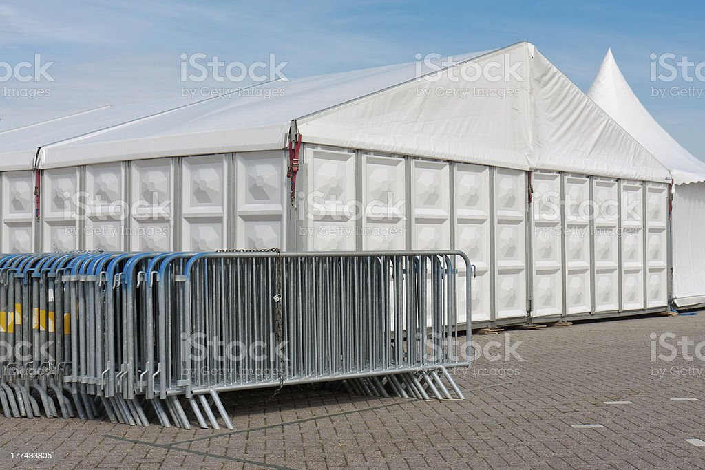 Crush barriers near a big marquee stock photo