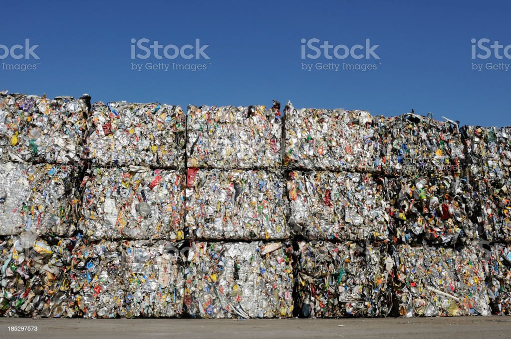 Crushed baled metal for recycling stock photo