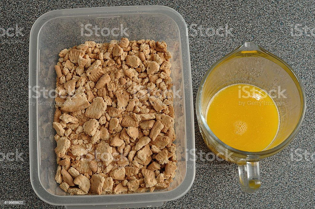 Crushed biscuits and melted butter stock photo