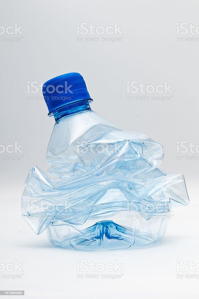 crushed bottle stock photo