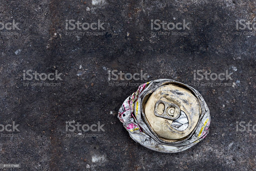crushed can on the road stock photo