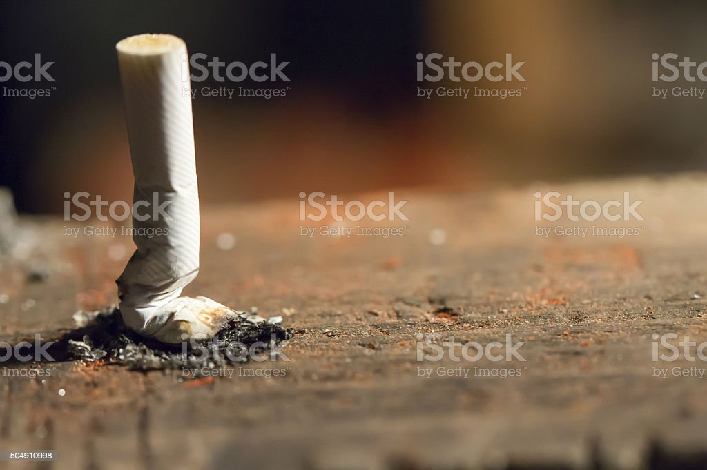 crushed cigarette stock photo