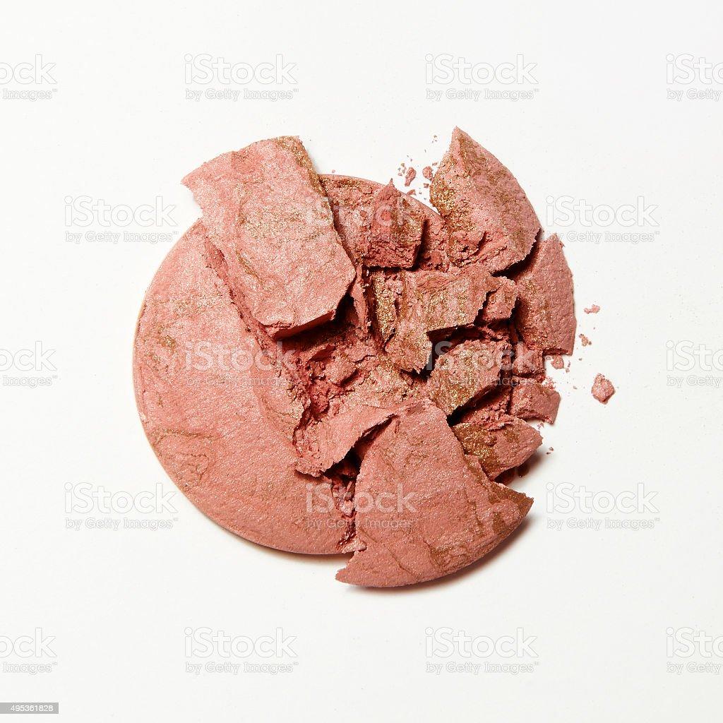 crushed crumbled pink blush and eyeshadow on white background stock photo