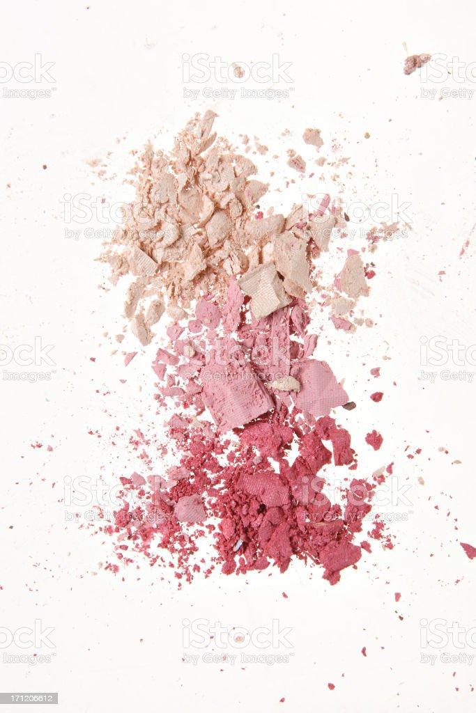 Crushed makeup powder in pink tones stock photo