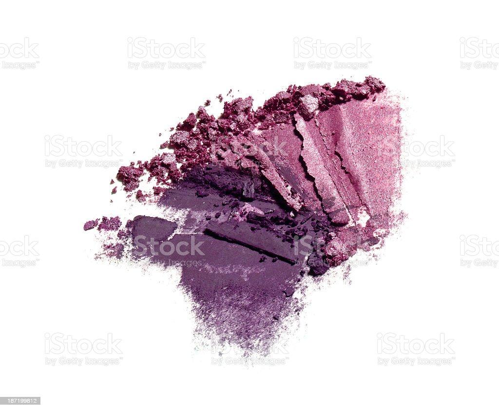 Crushed mauve and purple eyeshadows isolated on white stock photo