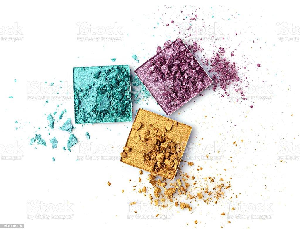Crushed multicolored eyeshadows stock photo