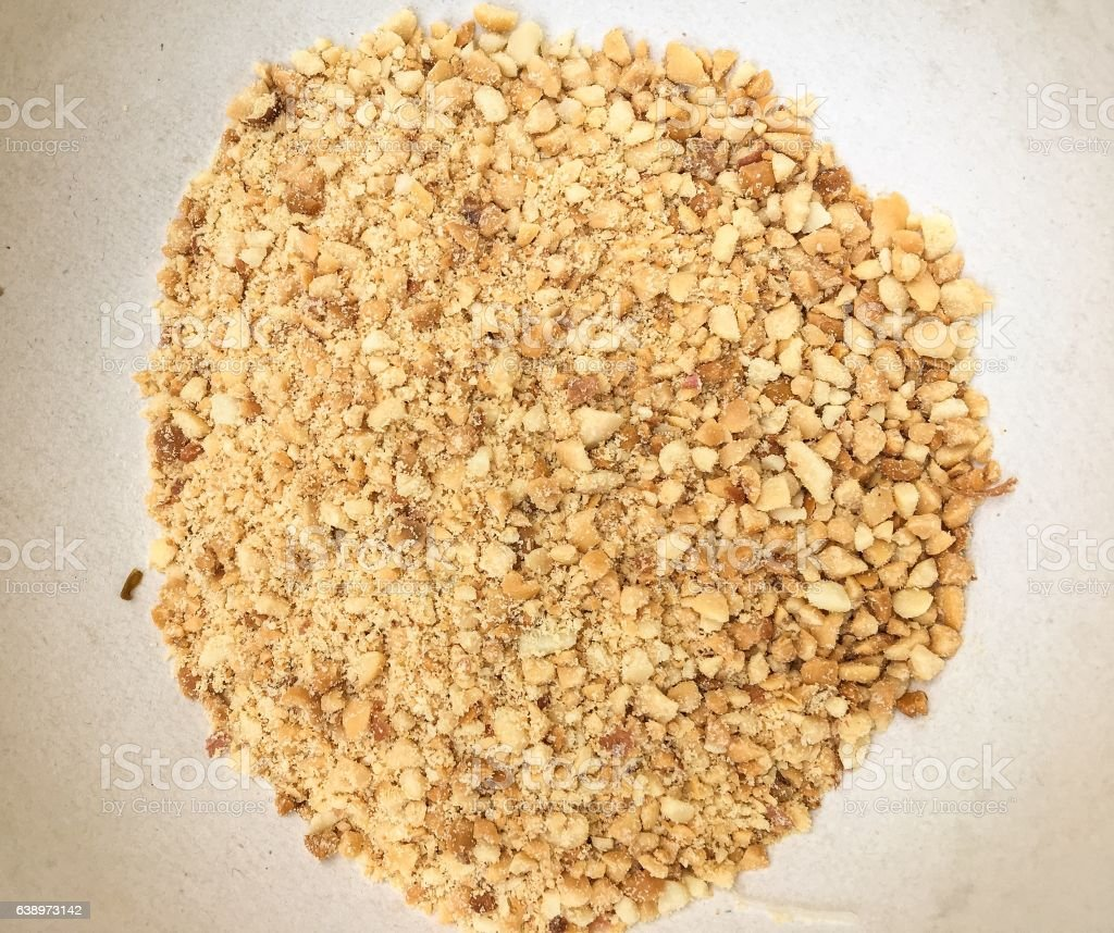 crushed peanuts stock photo