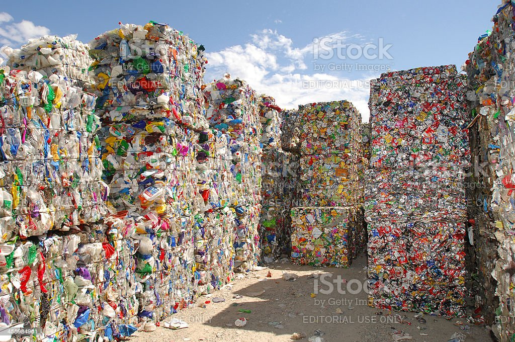 Crushed plastic and aluminium containers for waste disposal. stock photo